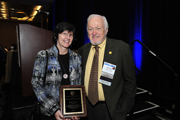Wendy Rogers receiving the award from the Award Chair Dr. Richard Hornick